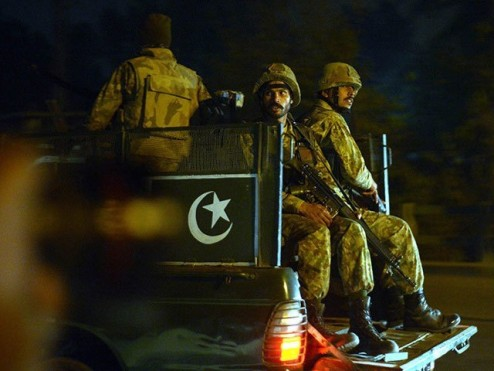 Pakistani army personnel patrol the streets following an attack by Taliban gunmen on a school in Peshawar on December 16, 2014. PHOTO: AFP
