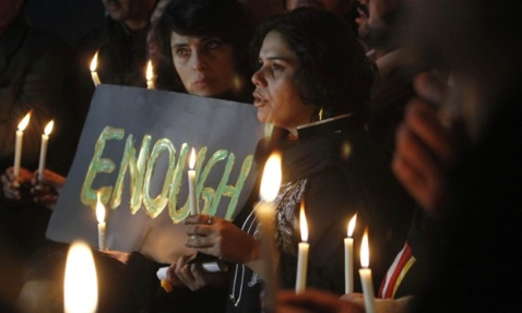 Pakistan civil society members gather for a vigil to pay tribute to the victims of the school attack in Peshawar